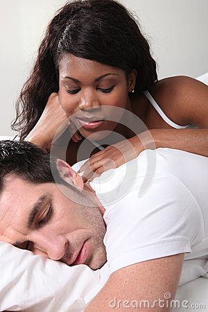 Mixed couple in bed