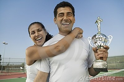 Mixed doubles Tennis Players holding trophy