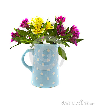 Mixed flowers in blue jug