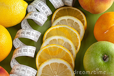 Mixed fruits and tape measure