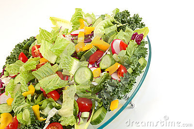 Mixed green vegetables on glass plate from angle with isolated w