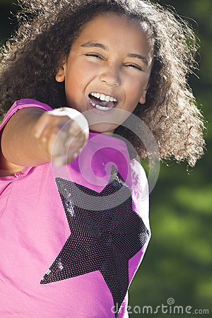 Mixed Race African American Girl Smiling Pointing