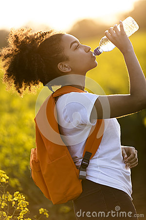 Free Mixed Race African American Girl Teenager Drinking Water At Suns Stock Images - 90363834