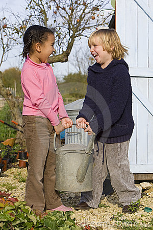 Free Mixed Race Children Gardening Holding Watering Can Stock Photo - 3569380