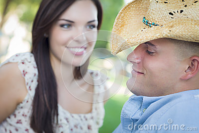 Mixed Race Country Couple with Cowboy Hat Flirting in Park