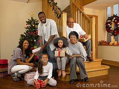 Mixed race family around christmas tree