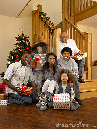 Mixed race family exchanging gifts at christmas