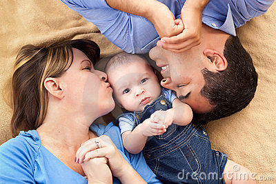 Mixed Race Family Snuggling on a Blanket