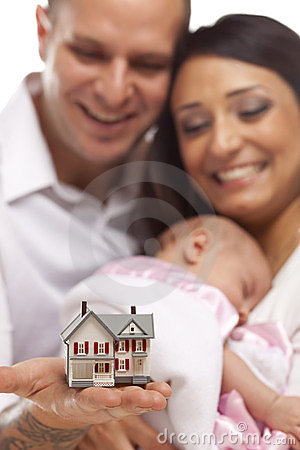 Free Mixed Race Family With Small Model House Royalty Free Stock Photography - 24143567