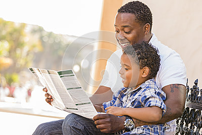Mixed Race Father and Son Reading Park Brochure