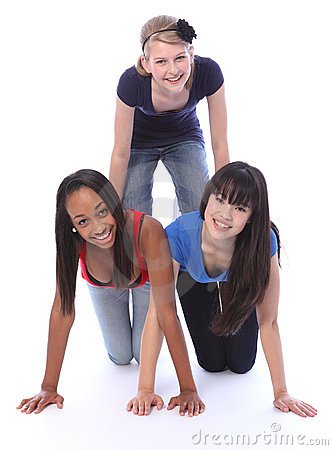 Mixed race teenage girl friends in fun pyramid