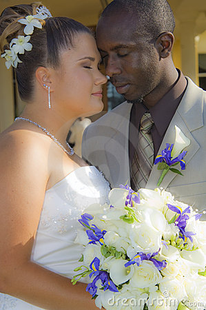 Mixed race wedding couple faces