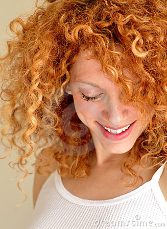 Mixed young woman  with curly hair