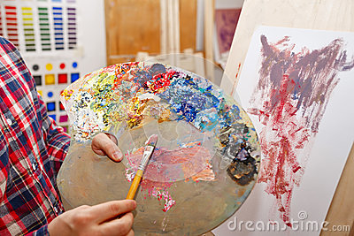 Mixing of oil paints Stock Photo