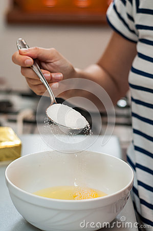 Mixing sugar and eggs