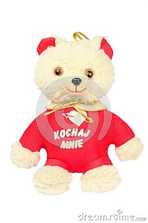 Mjuk leksakbjörn med en hjärta