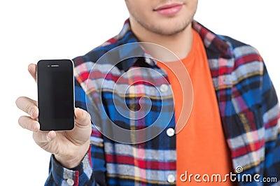 Män med mobiltelefonen.