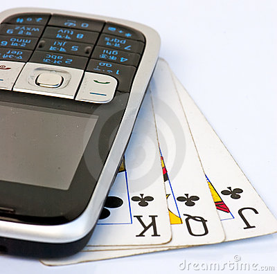 Mobile phone on 3 used playing cards