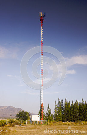 Mobile phone communication antenna tower sky blue