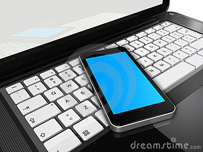 Mobile phone on a laptop