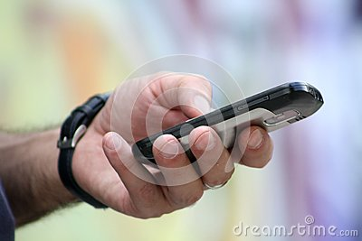 Mobile phone in man s hand