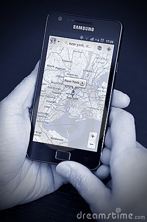 Mobile Phone with navigation maps Editorial Photo