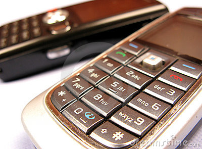Mobile phones over white