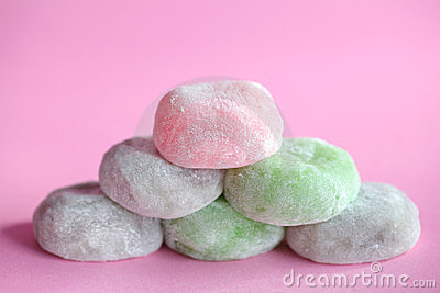 Mochi colorful japanese rice cakes stacked on pink