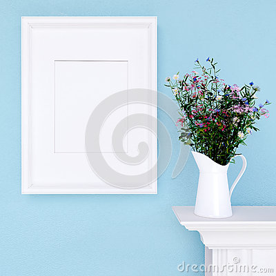 Free Mock Up Poster And Wildflowers On A Dresser With Blue Wall Royalty Free Stock Photo - 57392015