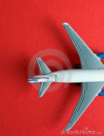 Model aircraft on red
