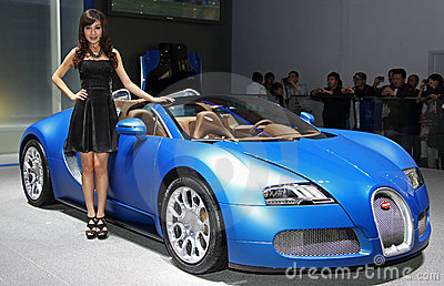 A model and a Bugatti Veyron 16.4 Grand Sport Editorial Photography