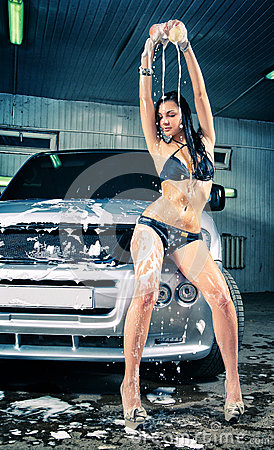 Model at the car wash in garage.
