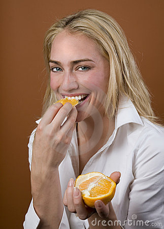 Model eating orange