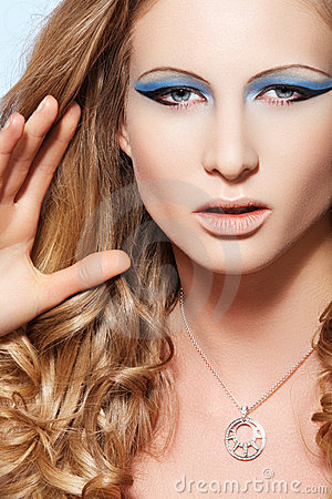 Model with fashion make-up, long hair and jewelry