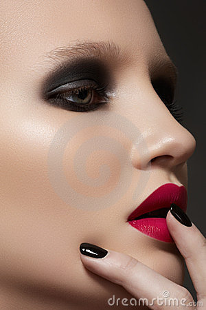 Model with fashion make-up, manicure & vinous lips