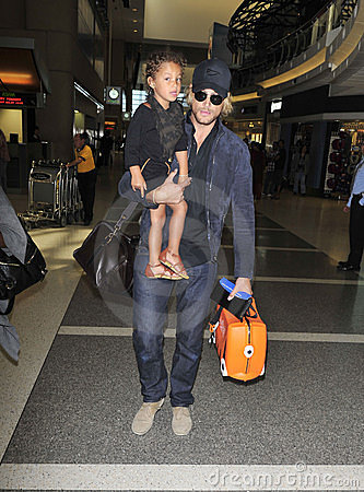 Model Gabriel Aubry with daughter at LAX airport Editorial Stock Image