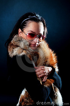Model holding fox fur