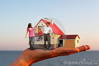 Model of hous on hand and family