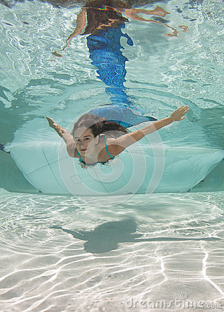 Free Model In A Pool Wearing A Mermaid`s Tail. Royalty Free Stock Images - 92621169