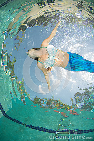 Free Model In A Pool Wearing A Mermaid`s Tail. Stock Photos - 92621223