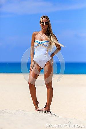 Free Model In White Swimsuit Posing At The Beach Royalty Free Stock Image - 119868426