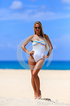 Free Model In White Swimsuit Posing At The Beach Stock Photos - 119868673
