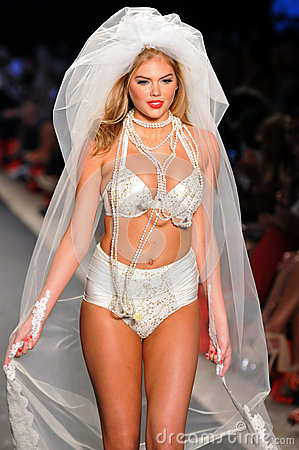 Model Kate Upton walks runway at the Beach Bunny Swimsuit Collection for Spring/ Summer 2012 Editorial Photography