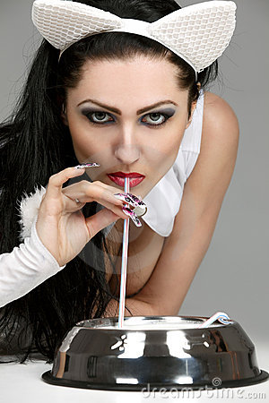 Model in latex white cat costume drinking milk