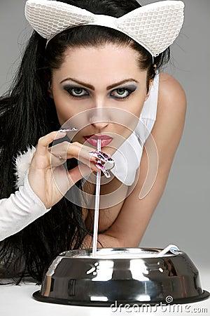 Model in latex white cat costume drinking milk