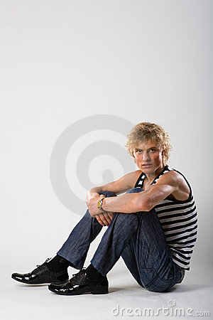 Model man sit in jeans and shirt