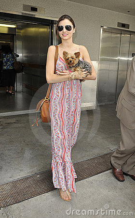 Model Miranda Kerr is seen with her dog at LAX Editorial Stock Photo