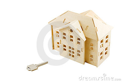 Model of modern house with key