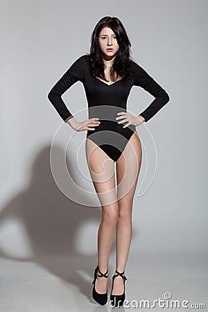 Model posing, hands on waist