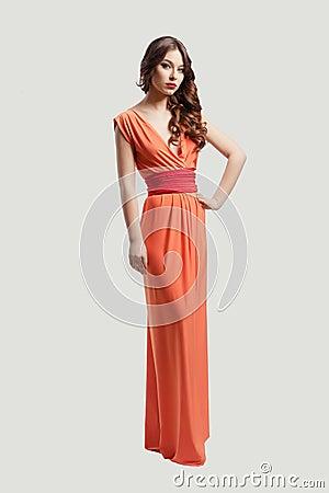 Model posing in orange dress